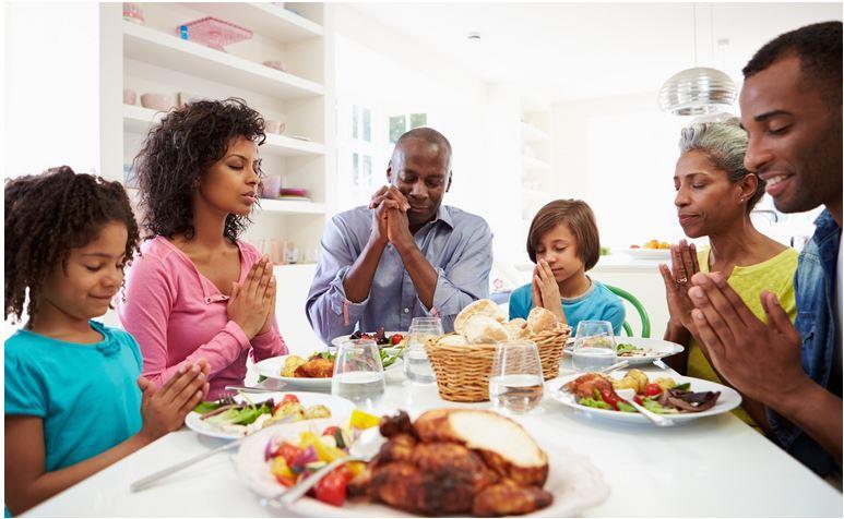 praying-family-holiday-dinner.jpg